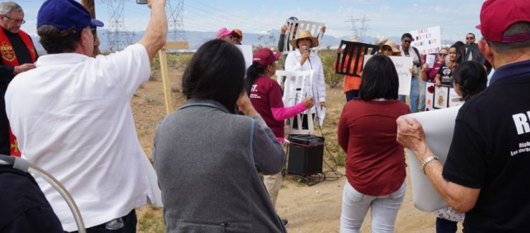 Hilda Cruz speaks to a group gathered for immigrant Stations of the Cross outside the Adelanto Detention Facility in California on Good Friday, April 19. (Photo by Marge Bitetti)